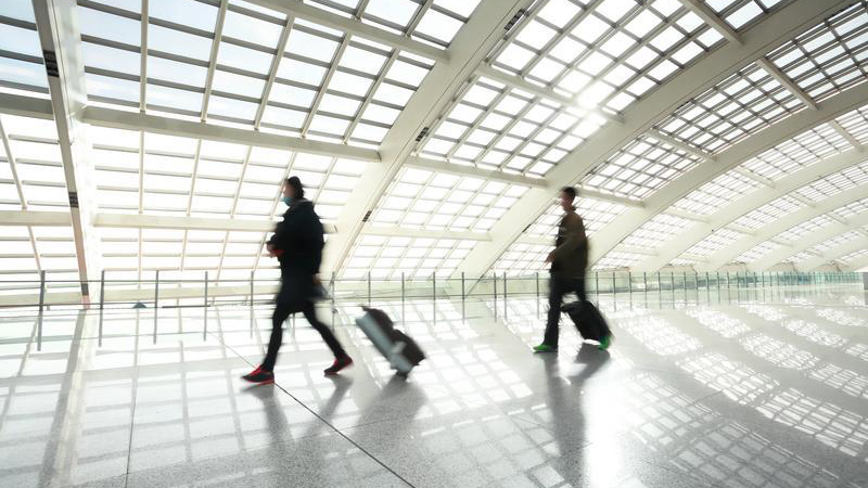 People walking through airport.